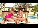 Rebecca and Cipriana touch and lick each other near the pool on Sapphic Erotica